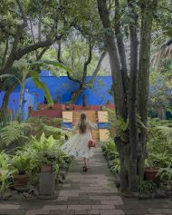 The perfect place for a twirling flow dress photo-op. Jacklyn Shields twirls with her dress at Casa Azul in Mexico, City, Mexico