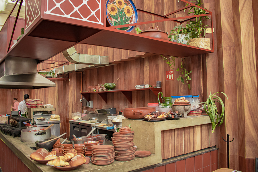 Potted plants and terracotta hues make up the beautiful open kitchen at Pasillo de Humo in Condesa, Mexico City.